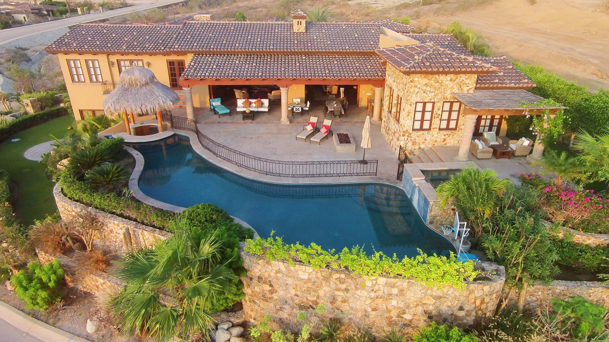 At this luxury villa, residents can enjoy cocktails at the swim-up tiki bar after a round of golf at Mexico's No. 1 rated course.