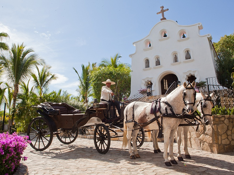 Tying the knot at the luxurious One&Only Palmilla hotel means a ride in a horse-drawn carriage to its very own wedding chapel.