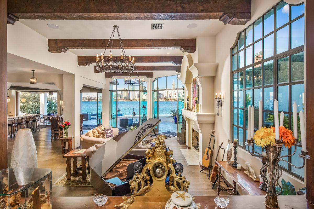On one of the largest waterfront lots in San Diego, this exquisite coastal home boasts more than 65 feet of San Diego Bay frontage, a LEED-certified luxury residence, and a separate guest house.