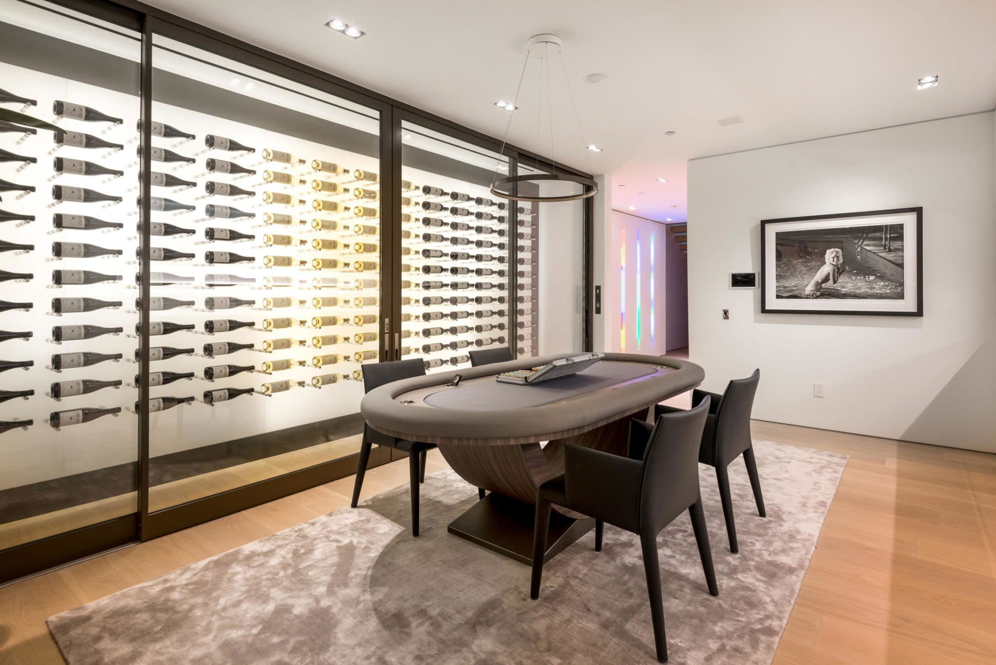 This architectural marvel is equipped with the latest in-home inspirations and cutting-edge technology, including this one-of-a-kind 600-bottle wine room with a floating backlit display, accessed via a thumbprint recognition system.