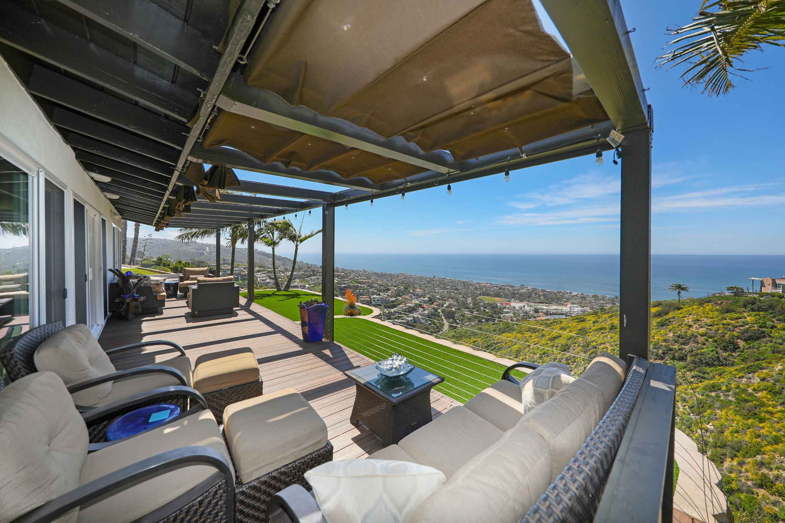 This Laguna Beach, California, home conserves water with synthetic lawns and enjoys an adjacent vegetable and herb garden.