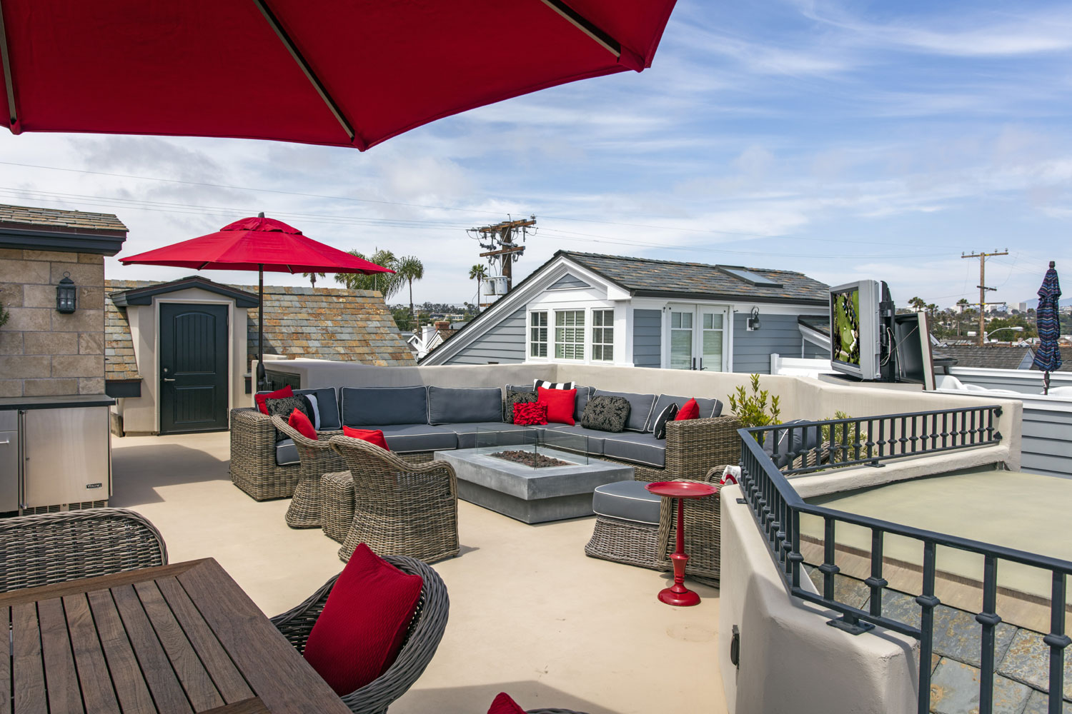 Bay views are in competition with the on-screen action at this home's entertaining area, complete with HDTV, fireplace, lounge, dining area, and commercial-grade grilling station.