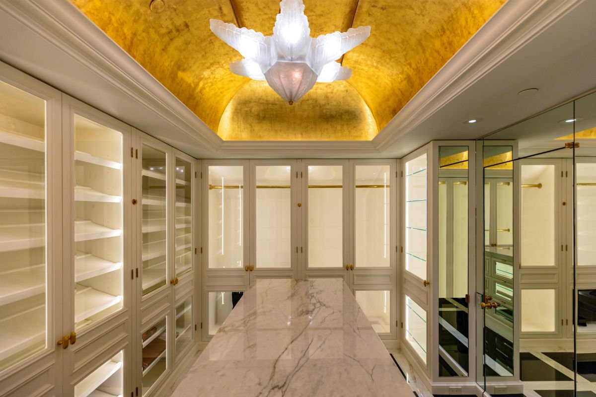 The Rutherford House is an Art Deco masterpiece overlooking the prestigious Los Angeles Country Club golf course. The estate's glamorous amenities include a private master suite with a walk-in closet and dressing area adorned with marble floors and a domed ceiling.