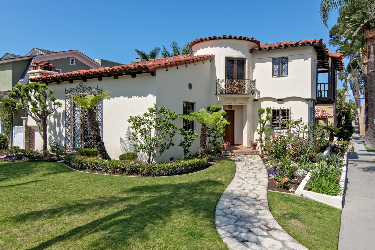 The essence of classic, California Spanish architecture is captured in this 2,300-square-foot, turreted home in the historic Long Beach enclave of Belmont Heights. Its elegant exterior exudes privacy, yet encloses a lush, open courtyard.