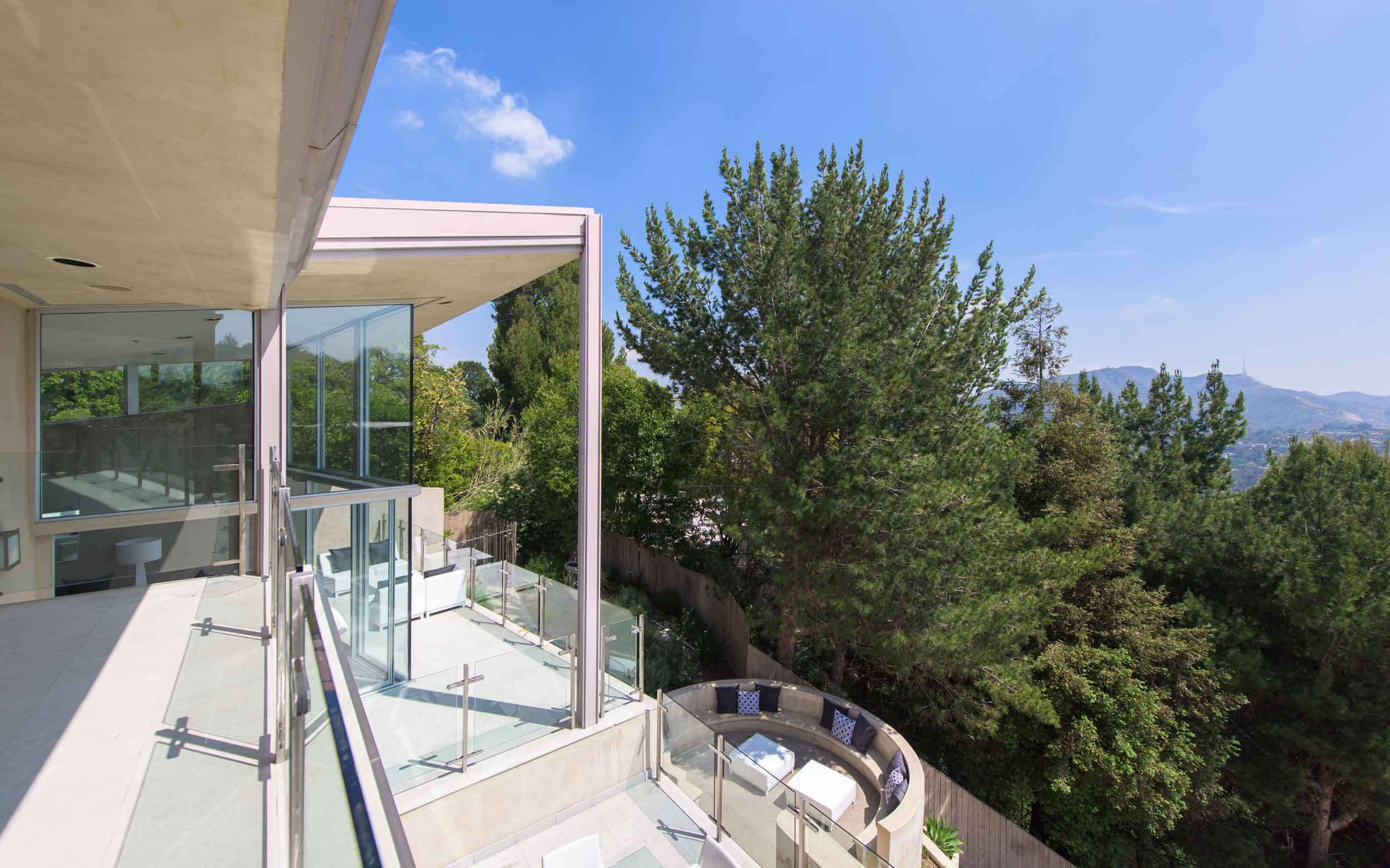 With stellar views of the Hollywood Hills and the famous Hollywood Bowl Fourth of July fireworks, this gated compound on Mulholland Drive affords a lifestyle suited to the rich and famous.
