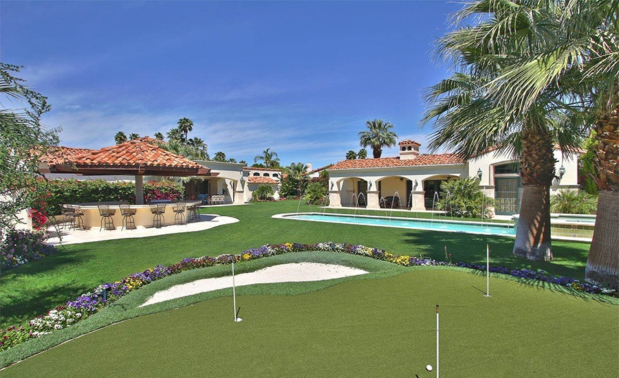 This spacious Rancho Mirage estate has numerous outdoor amenities including a private putting green ideal for perfecting one's golf swing in a low-key setting.