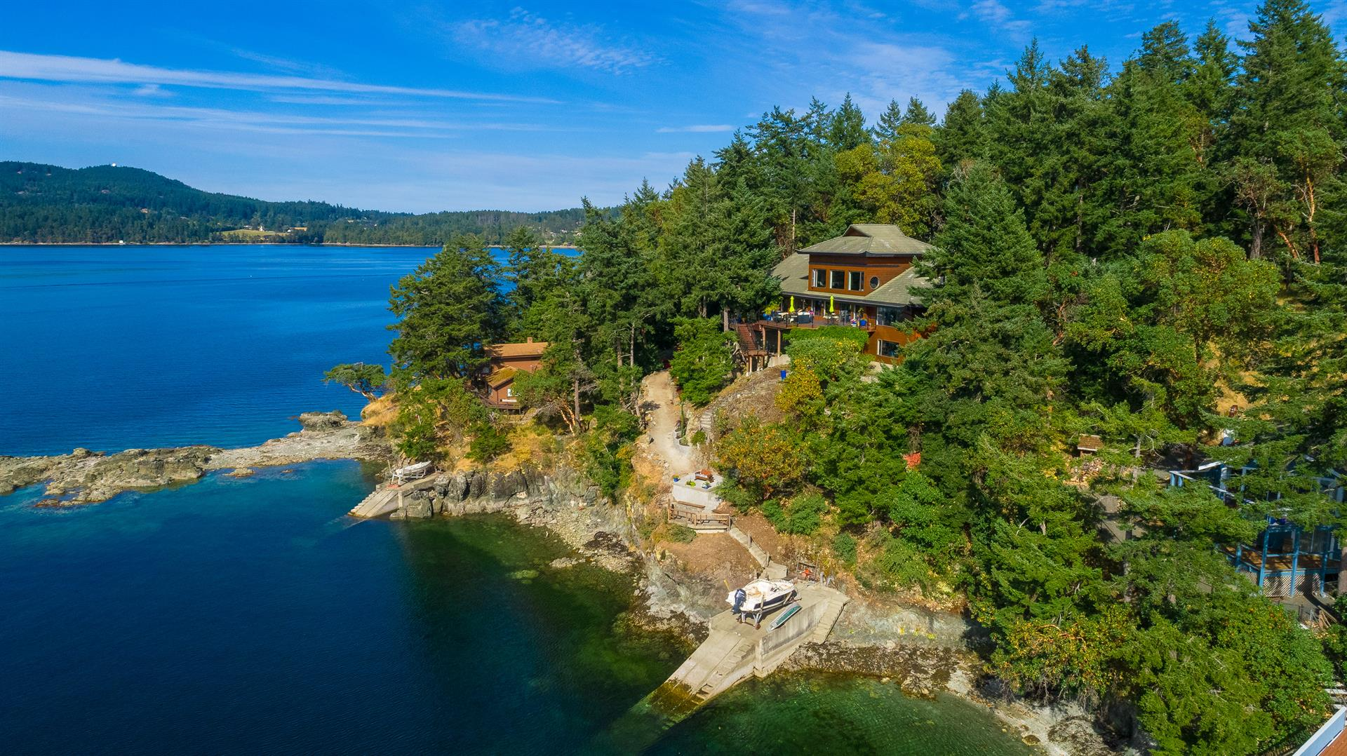 The evergreen forests of Gowlland Tod Provincial Park set the scene for this Asian-inspired home on Vancouver Island, British Columbia.