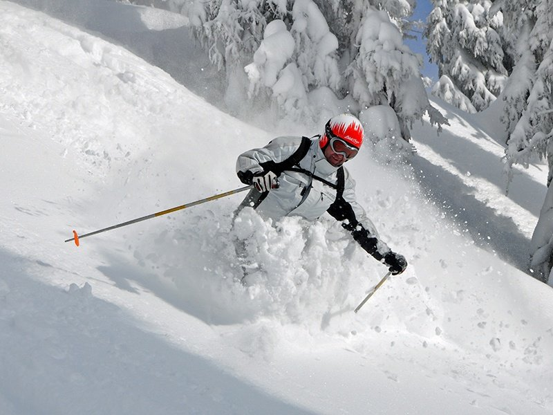 When powder skiing, the key is to distribute your weight equally to left and right, and turn both skis as a unit; it takes practice, and powder skis, rather than regular carvers, are a must.