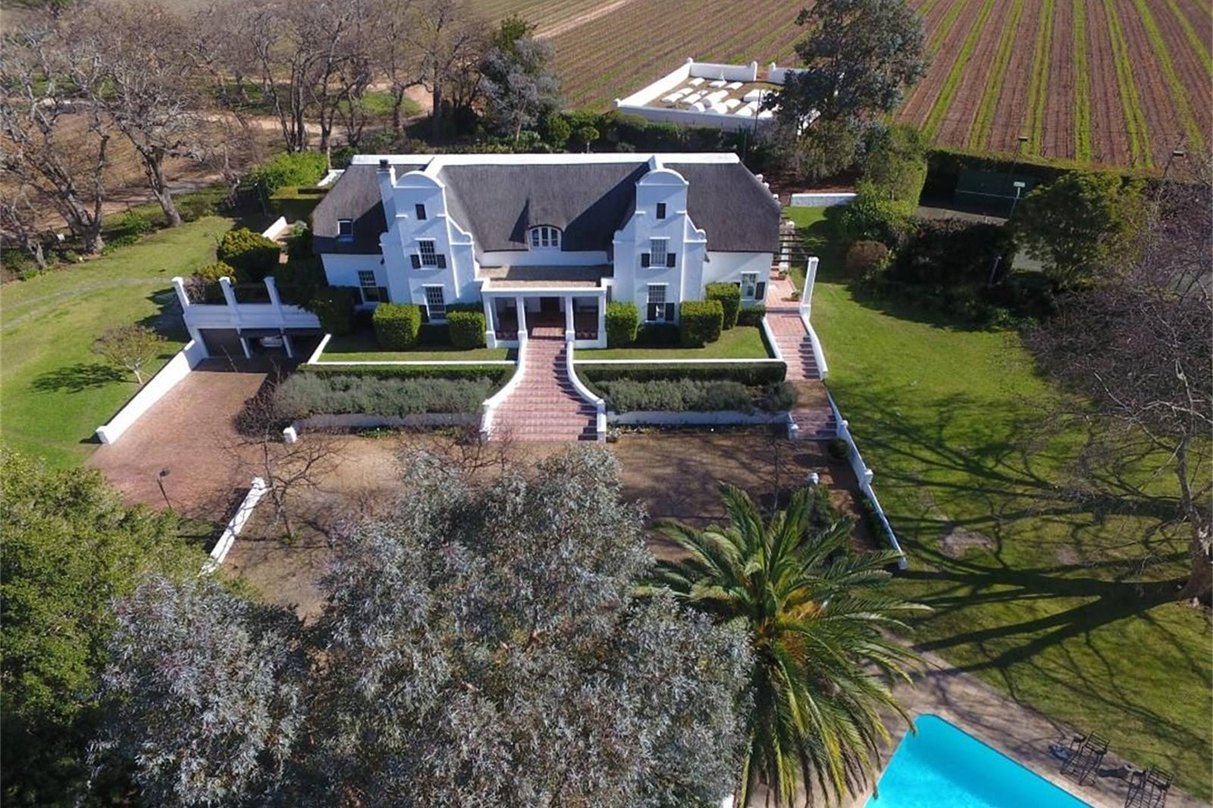 This manor house in the Constantia Valley wine region was inspired by the 18th- and 19th-century Cape Dutch homesteads of the Western Cape.
