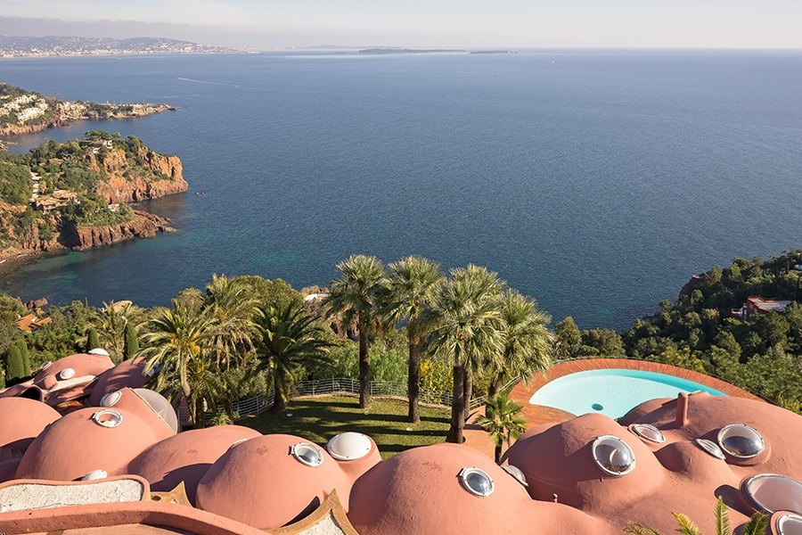 The Bubble House's many vantage points serve up spectacular views of the Bay of Cannes framed by palm trees and blue sky.