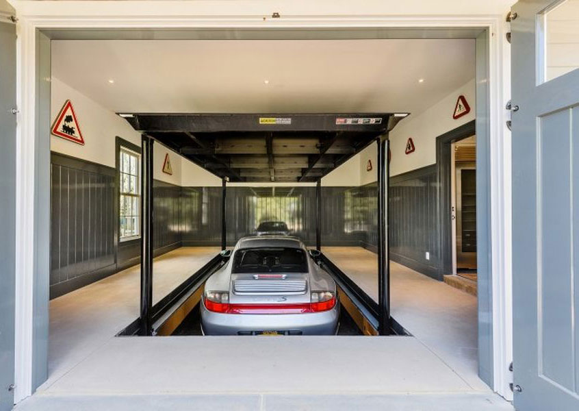 One highlight of this home is the glass-enclosed carport showcase, with a custom car lift to the ground-floor garage.