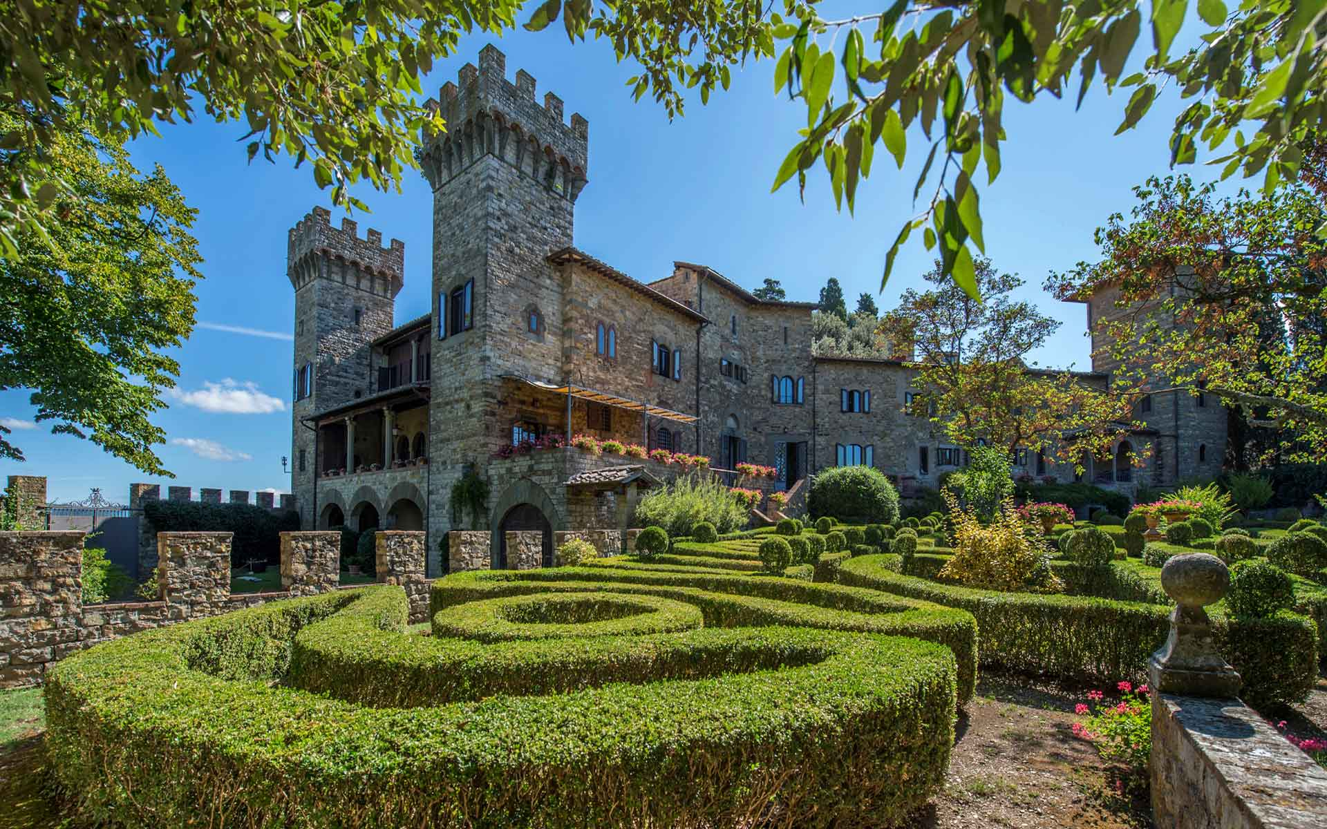 This Gothic castle and vineyard estate has a breathtaking location in the Chianti Classico wine region, between Florence and Sienna.