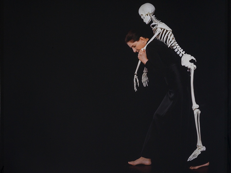 Marina Abramović's work includes staged photographs like <i>Carrying the Skeleton</i>, from 2008. Photograph: Marina Abramović, courtesy of Lisson Gallery. Banner image: <i>Olympia</i> by Édouard Manet. Photograph: Alamy