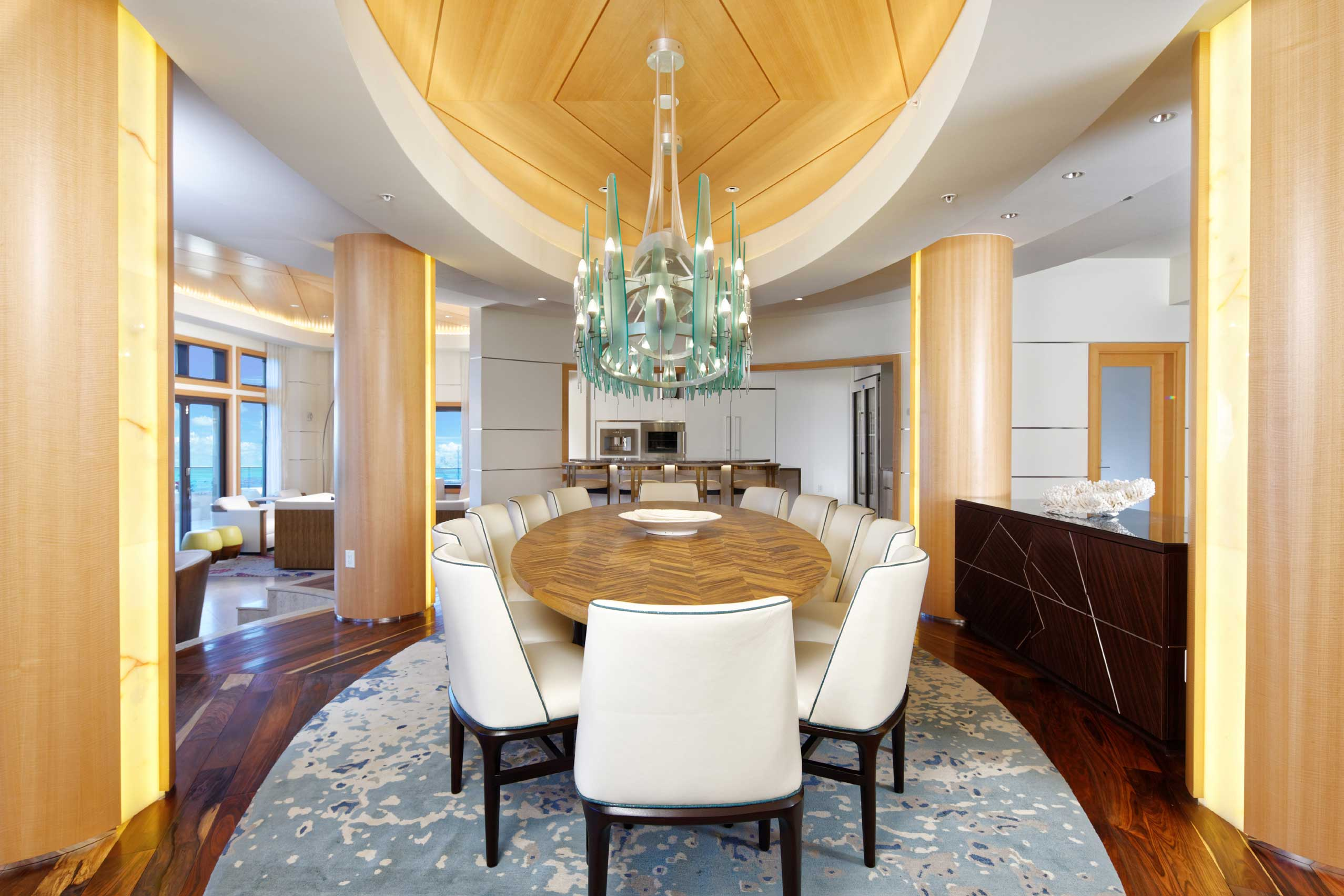 Atop the Ritz-Carlton Grand Cayman, 700 Seven South is one of the Caribbean's finest properties. The interior boasts impeccable finishes throughout, including this striking bespoke light fixture suspended above the dining room table.