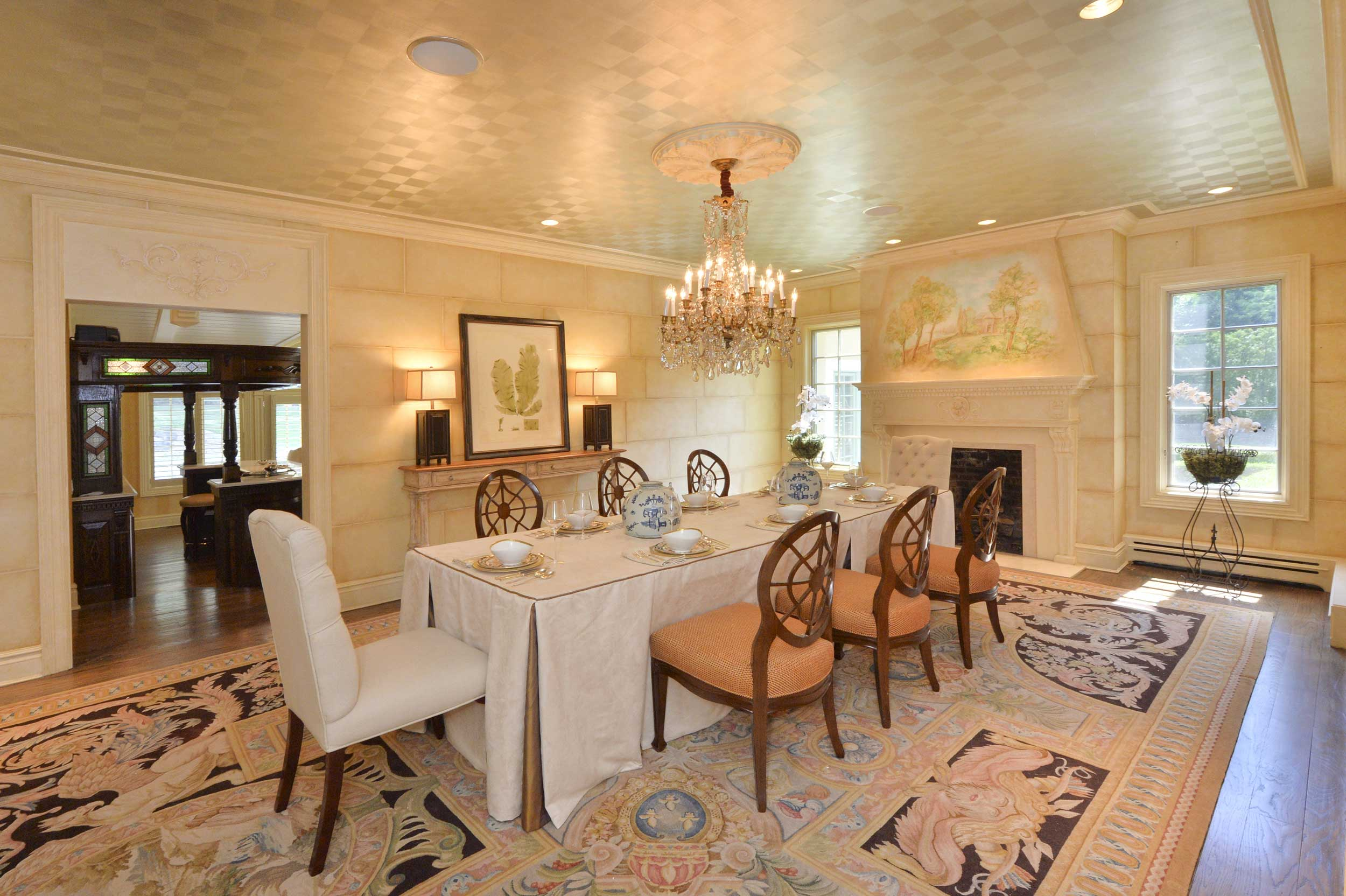 Michael Moore can picture hosting an artistic fundraiser at this home, furnishing the dining room with a George III Mahogany dining table.