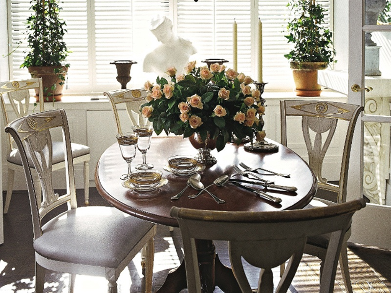 Tall windows and natural light can help to create a sense of warmth and serenity in a dining room, as proven by this design by Charles Spada.