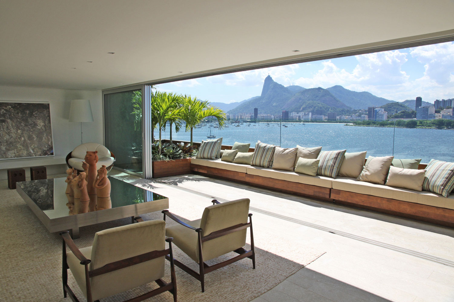 "The pinnacle of high-end living, this Rio penthouse captures enviable views of the Atlantic Ocean, Sugarloaf Mountain, and the iconic Christ the Redeemer statue, which is also counted among the ""New7Wonders of the World."""