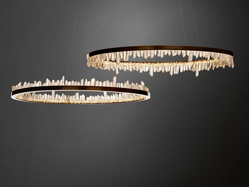 """Christopher Boots's """"rough-luxe"""" limited-edition Prometheus I+II pendants are made from brass and quartz crystal."""