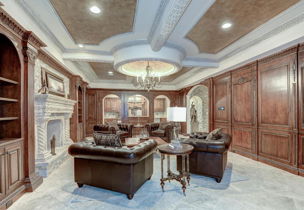 This eight-bedroom home in McLean, Virginia, offers an array of experiential amenities for the luxury connoisseur: a cigar room, wine cellar, billiards room, mahogany-paneled library, and plush cinema.