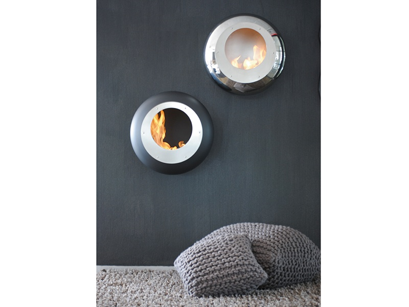 The wall-mounted Vellum fireplace by Cocoon, in a black or stainless-steel finish, has a diameter of 23.7 inches and burns for up to six hours.