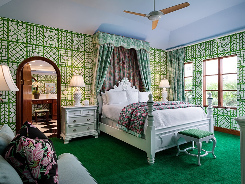 Palm Beach's Colony Hotel, opened in 1947, offers a colorful and quirky take on colonial style, from its flamingo-pink exterior to bedrooms and suites decked out in cheerful floral prints with a distinctly Floridian flavor.