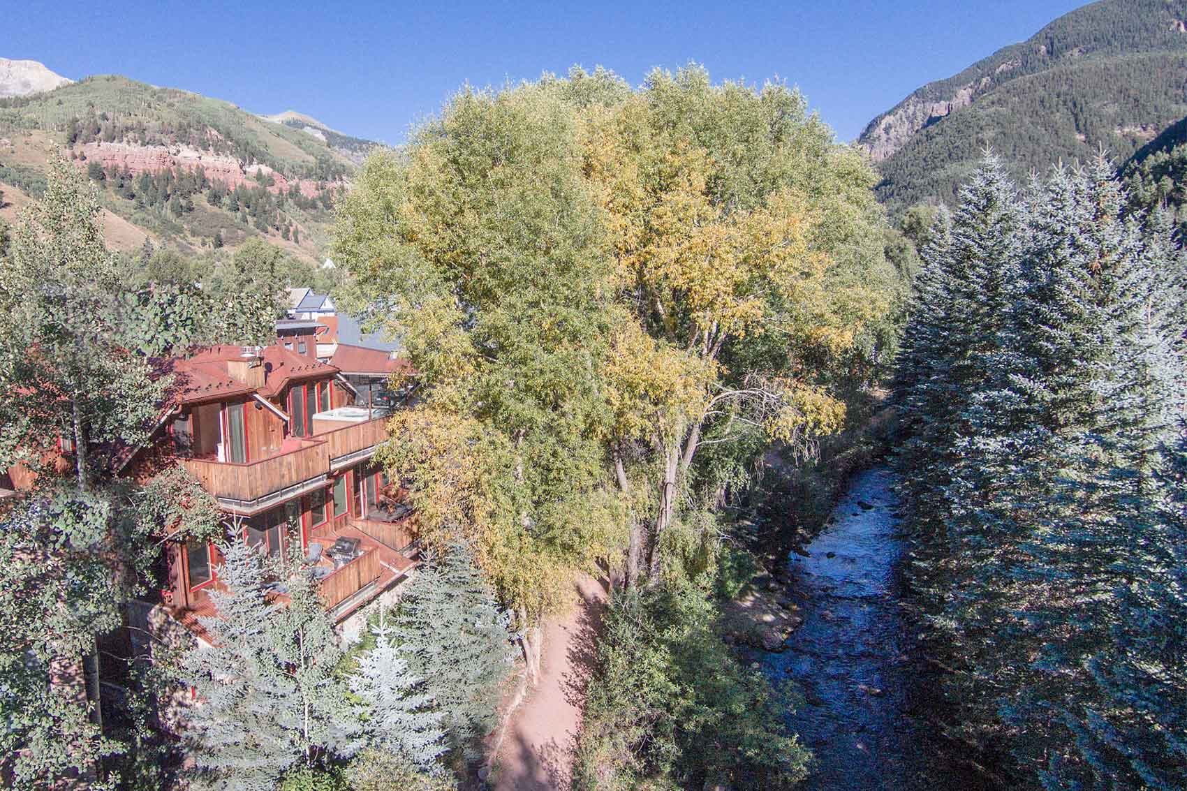 This idyllic home in Telluride boasts dramatic views of the San Miguel River and the forests of box canyon, steps from the Gondola ski lift.