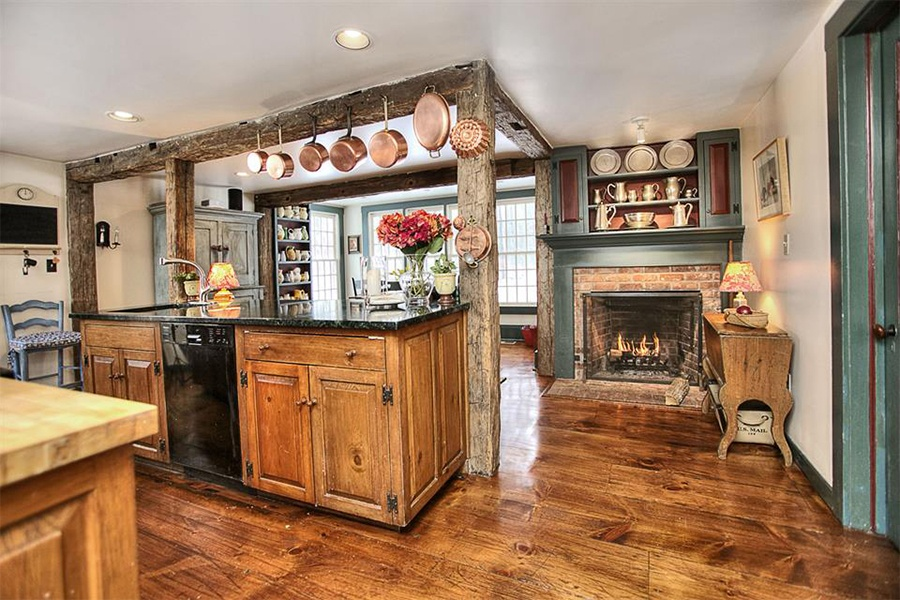 A Revolutionary War-era masterpiece, this landmark Colonial is just a 10-minute walk from the town center, has been updated with modern systems and conveniences, and features exquisitely manicured grounds and a barn.