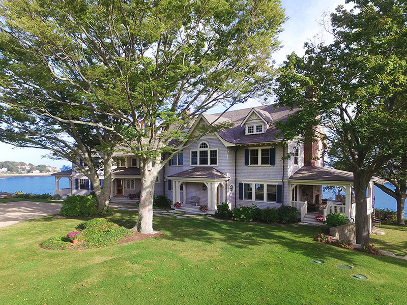 Walls of windows and French doors provide unparalleled vistas of the North Shore, Massachusetts Bay, and the Boston skyline at this magnificent estate on the southeastern tip of Coolidge Point. On the market with LandVest Inc., an exclusive affiliate of Christie's International Real Estate.