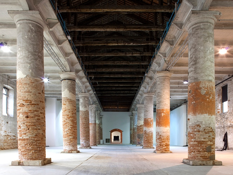 The Corderie building within the Arsenale complex was originally used for the production of mooring cables and naval ropes. Left in a partially restored state, it is the ideal canvas for the contemporary artworks of La Biennale. Photograph: Giulio Squillacciotti
