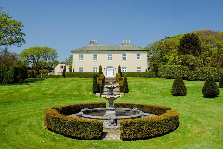 The Georgian estate of Burren House in Kilbrittain offers a classic Irish countryside experience with beautifully landscaped grounds, an orchard, and unobstructed coastal views.