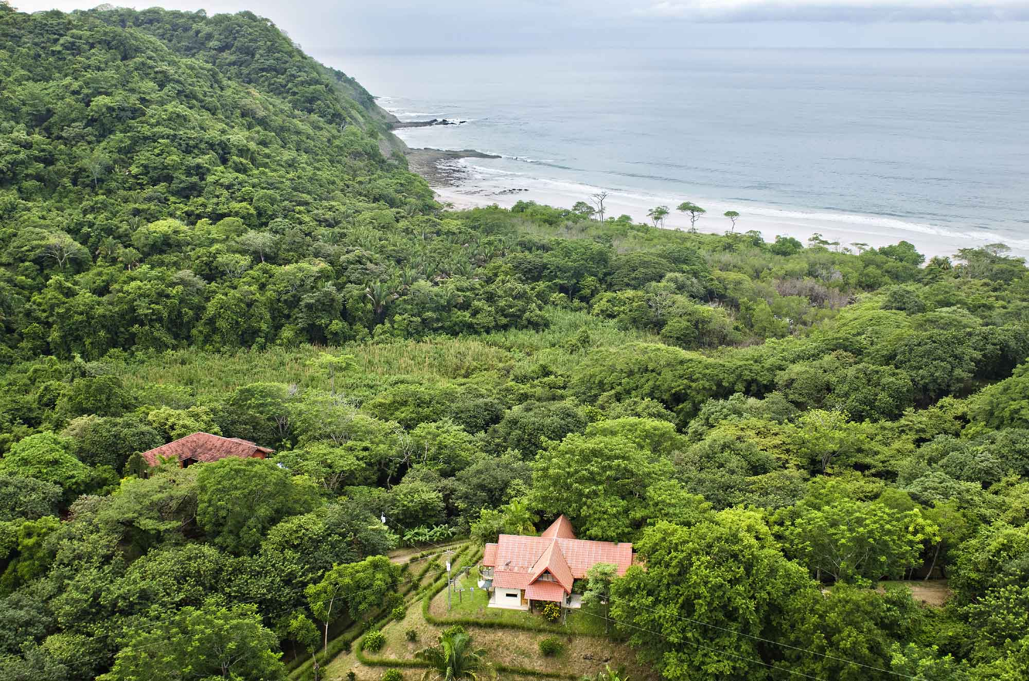 The sights and sounds of the jungle envelop Playa Barrigona, Mel Gibson's magnificent 403-acre estate on the Pacific coast of Costa Rica.