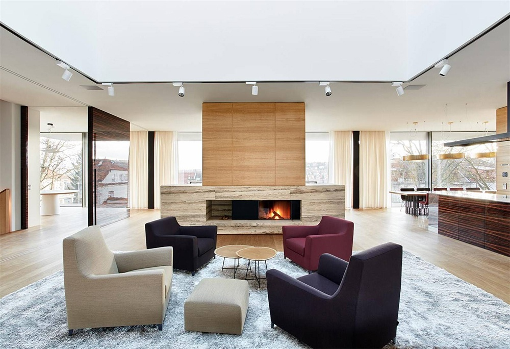 This contemporary home in Prague is accented with artistic finishes, including an Italian Travertine fireplace in the main living area.