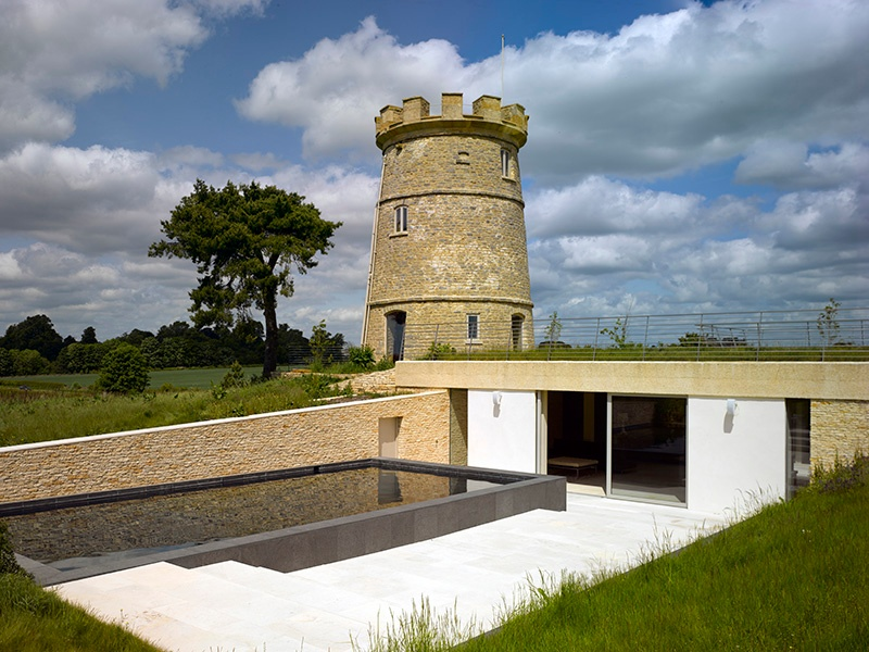 """The extension of the Round Tower is discreet, built underground to allow the tower to remain the dominant structure. An open sunken courtyard and a """"landscape scoop"""" allow natural light to shine through. Photograph: Edmund Sumner"""