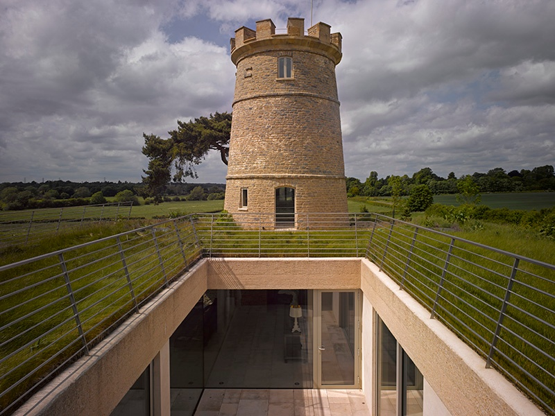 The Round Tower in England had been reduced to ruin before architecture firm De Matos Ryan revitalized it. Completed in 2009, it is now a home that maintains an open relationship with the surrounding landscape. Photograph: Edmund Sumner
