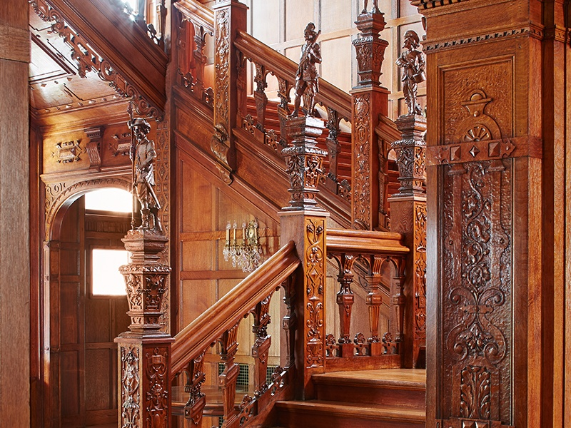 Elizabethan design influences the grand stairway, paneled in oak. Photograph: Laura Moss
