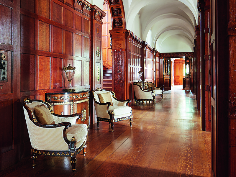A paneled corridor with vaulted ceiling separates the main entrance from the great hall. Photograph: Laura Moss