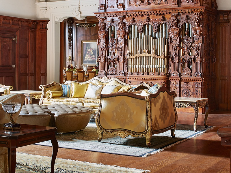 Fitted with silver Tiffany chandeliers and intricate details in rich, dark woods, the dramatic great hall also has a fully restored Aeolian player pipe organ. Photograph: Laura Moss