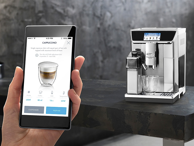 De'Longhi's PrimaDonna Elite, fully programmable and app-controlled, bean-to-cup coffee maker, with built-in bean grinder, steam wand, and two-liter water tank.
