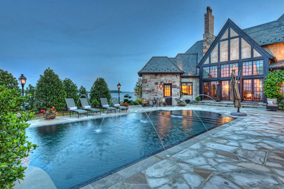 This grand 2.5-acre estate is on the shores of Lake Norman, a lake so large it is often referred to as an inland sea.