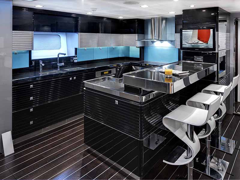 Features incorporated by Design Unlimited on the ultramodern <i>Bliss</i> superyacht include a stylish and well-equipped galley with breakfast bar.