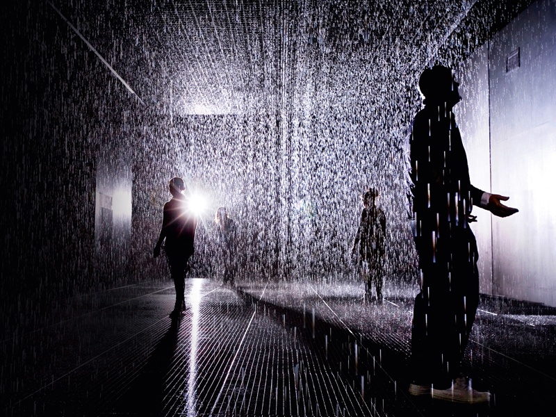 """Alongside a mixed media list that includes water, injection-molded tiles, solenoid valves, and pressure regulators, Random International's <i>Rain Room</i>, which opened at London's Barbican Centre in October 2012, made use of """"custom software"""" and """"3D tracking cameras."""" Photograph: Rain Room Installation image © Felix Clay, Rain Room – Random International 2012, Courtesy of Barbican Art Gallery. Banner image: A video still from Pipilotti Rist's <i>Mercy Garden Retour Skin</i> (2014) audio video installation. Banner photograph: © Pipilotti Rist, Courtesy the Artist, Hauser &amp; Wirth, and Luhring Augustine; Mark Metcalfe/Stringer/Getty Images"""