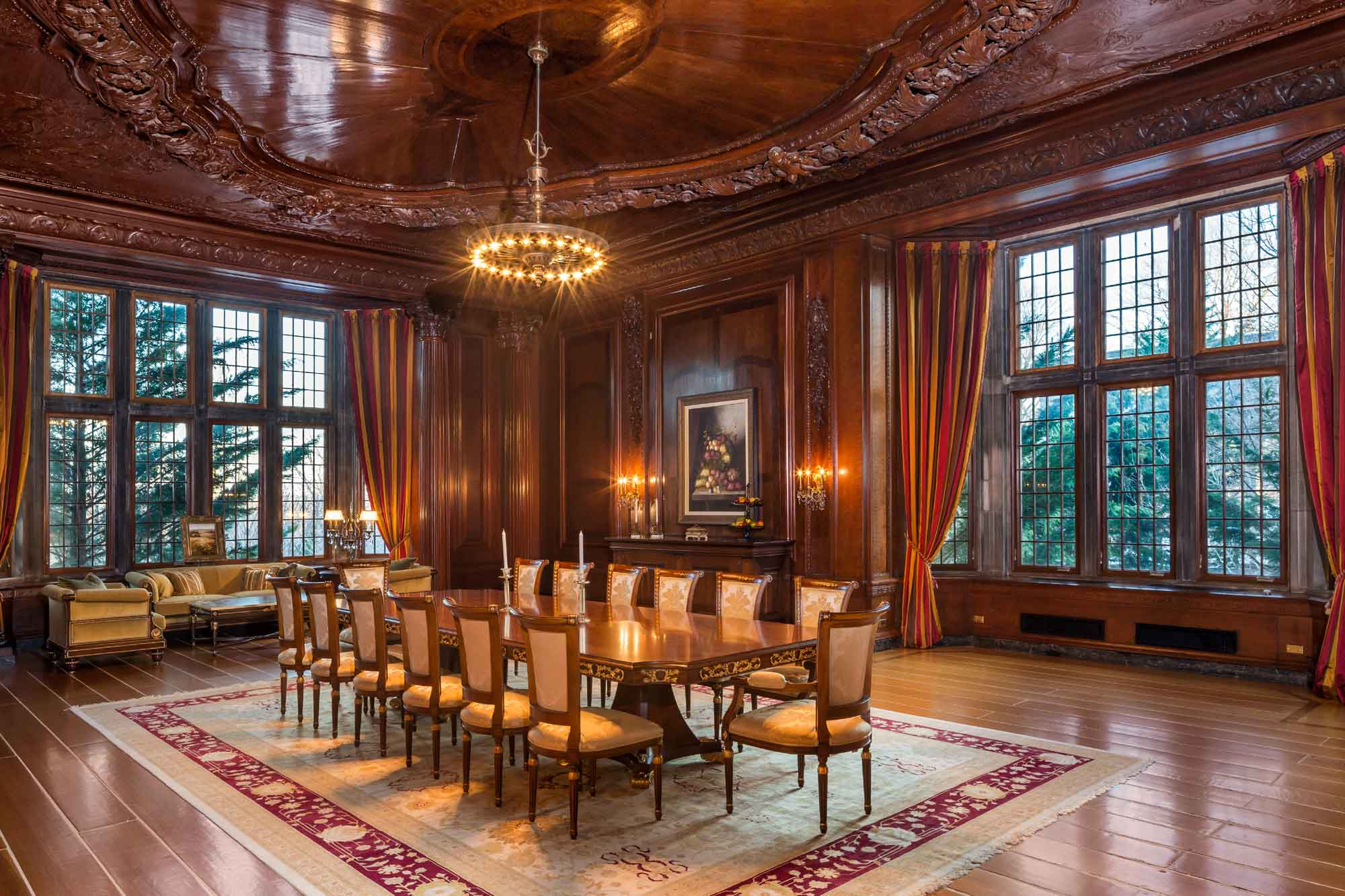 The formal dining room features a spectacular carved wooden ceiling.