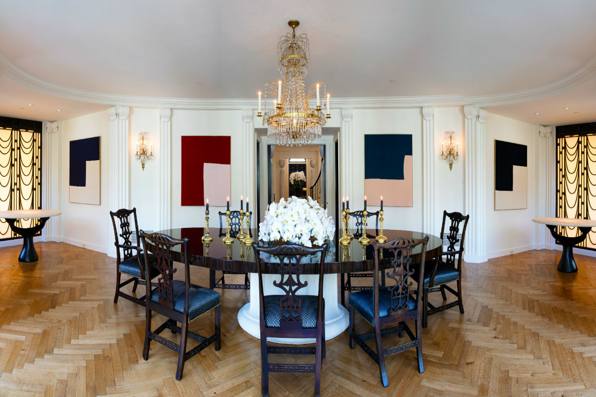 The spacious dining room displays classical and Art Deco influences and seats up to 24.