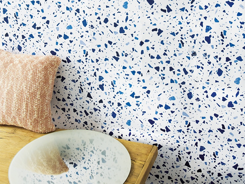 My Terrazza wallpaper from ENOstudio, in white with blue detailing; also available in dark blue and pink, both with multicolored detailing.