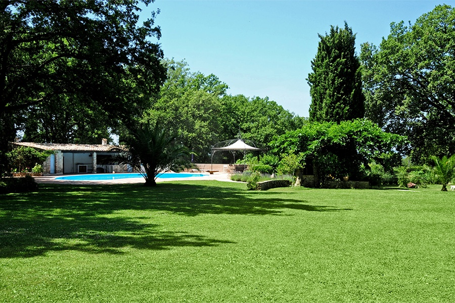 This property's 3.9 acres include a swimming pool, tennis and boules courts, and a caretaker's cottage.
