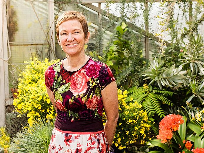 Elisabeth Condon, photographed exclusively for <i>Christie's International Real Estate</i> magazine, at Wave Hill, a public garden and cultural center in New York City, where she recently held a residency. Photograph: Laura Barisonzi. Banner image: <i>Quit Safari</i>, 2016. Acrylic, ink, and glitter on linen, 47 x 151 inches. Courtesy Emerson Dorsch Gallery, Miami, Florida/Phillip Reed