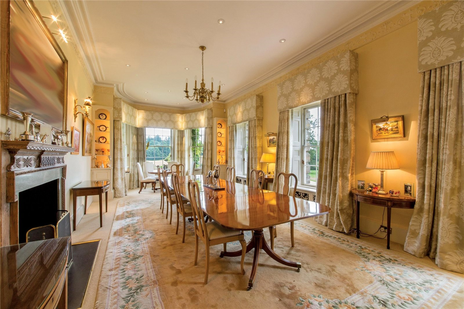 """Holly Golightly might admire """"the quietness and the proud look"""" of this home's charming breakfast nook, overlooking the pastoral grounds and situated just off the rather grand Georgian dining room."""
