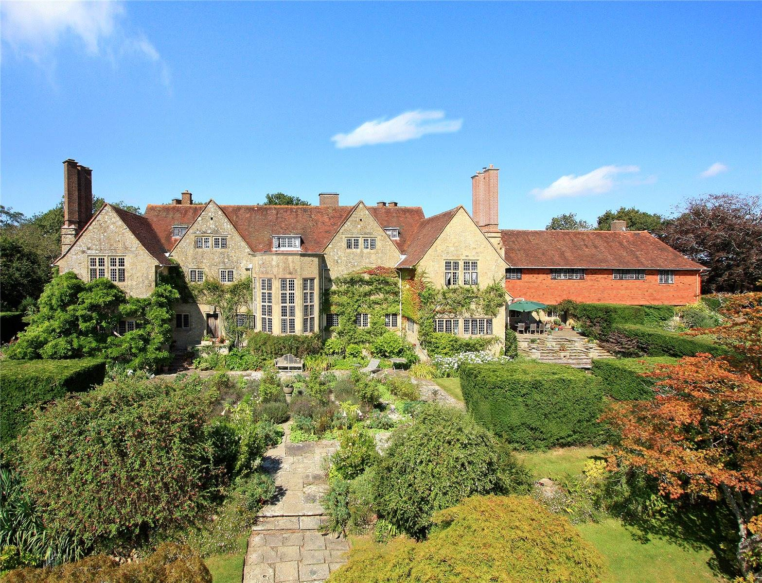 Magnificent mullioned windows are among the original Edwardian details of this Grade I-listed manor house overlooking England's South Downs National Park.