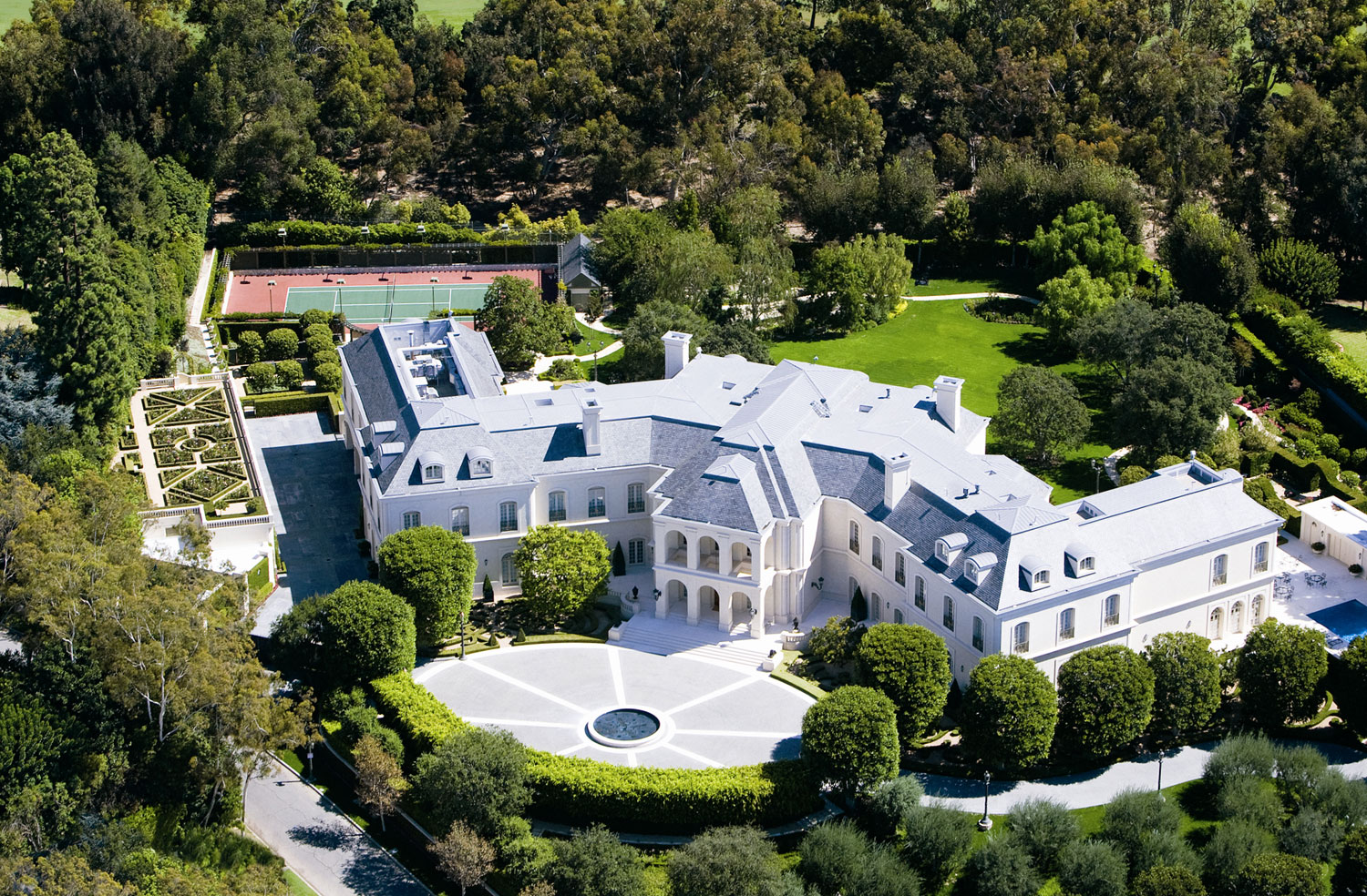 One of the world's most luxurious homes, The Manor was formerly owned by entertainment royalty Candy and Aaron Spelling; in 2011 the magnificent French château-style residence was updated with no expense spared.