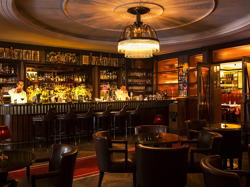 Drink bourbons, American whiskies and classic cocktails, surrounded by hundreds of photographs of celebrities, at Jimmy's, The Beaumont's American Bar.